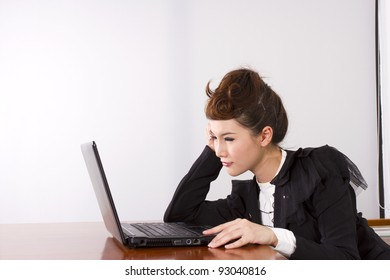 busy work, dress-up female model officer working with laptop.