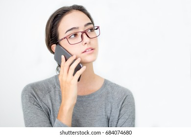 Busy young business lady talking on mobile phone