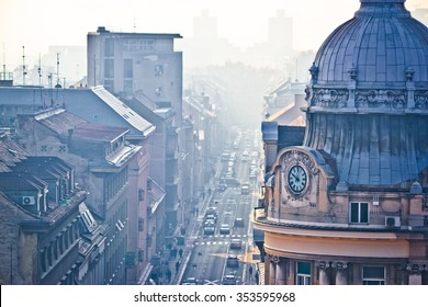 Busy Zagreb street in morning haze with old architecture aerial view, capital of Croatia