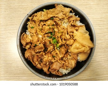 Buta Teriyaki don, or donburi, is a Japanese dish where simmered pork in a mildly sweet sauce is served atop a bowl of steamed rice. It also often includes onions and a sprinkling of leeks.