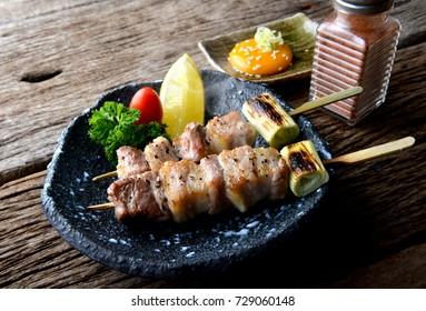 Butabara yakitori or Japanese bacon pork grill with salt and sauce serve in izakaya restaurant.
