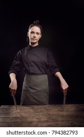A butcher girl on a dark background with a knife.