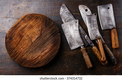 Butcher Meat cleavers large chef's knives and Chopping board block on wooden background