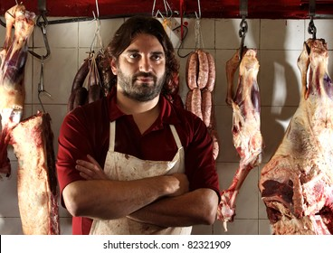 the butcher of the neighborhood in his shop