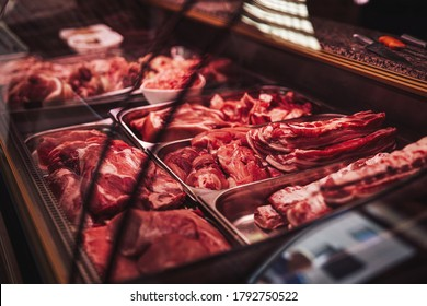 Butcher shop's counter with cold raw meat. Meat business. Selected quality meat selling.