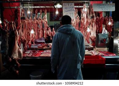 Butcher stands inside a public market in Thessaloniki, Greece on Apr. 11, 2014