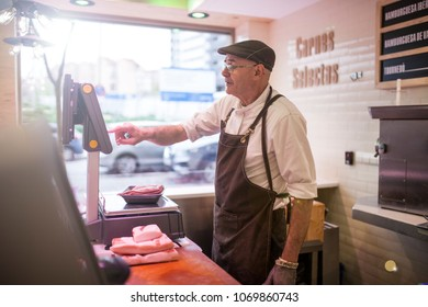 butcher weighing the meat and charging