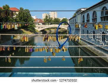 Butcher's Bridge in Ljubljana, Slovenia. Many padlocks are attached/fastened to the railing wires. Love bridge with padlocks concept to symbolize love to celebrate Valentine's Day.