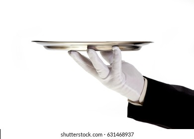 butler holding empty silver tray in gloved hand. White background