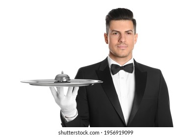 Butler holding metal tray with service bell on white background