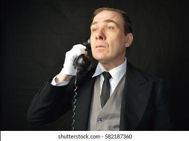 Butler on phone