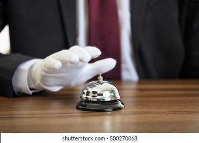 Butler service bell on a wooden surface
