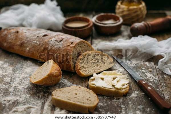 Butter and bread for breakfast over rustic wooden background