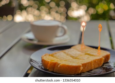 Butter bread and coffee on table