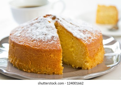 Butter cake with orange zest and juice by coffee