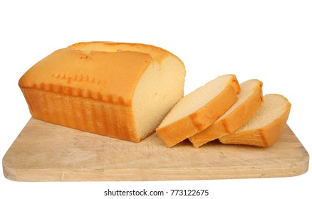Butter cake sliced on a wooden board isolated on white background.