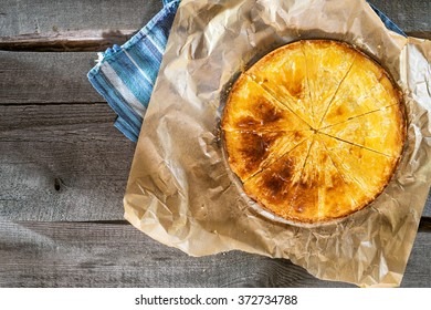 """Butter cake or sunny vanillia tart. Traditional almond Dutch cake called """"boterkoek"""" on a white background. Picnic for a summer vacation with perfect cake."""
