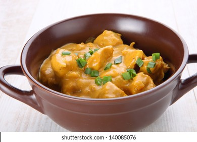 Butter chicken curry with basmati rice.