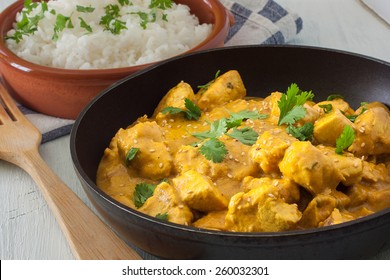 Butter chicken curry with basmati rice and cilantro.