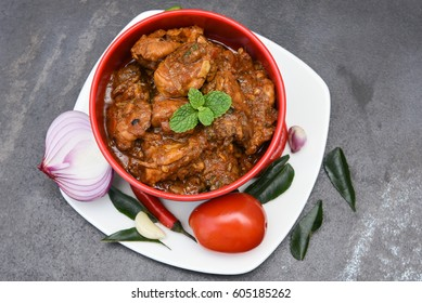 Butter chicken curry and ingredients, hot and spicy gravy dish Punjab, North India, korma, tikka masala, Kadai Indian food  prepared with spices. side dish for roti, phulka, chapati, naan, paratha.
