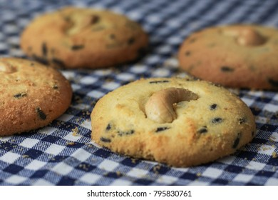 Butter cookies with cashew nut and chocolate chip on table cover with Fabric Scott.