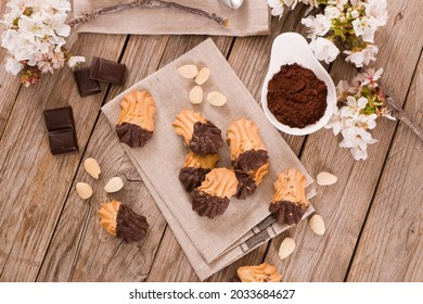 Butter cookies with chocolate on white dish.