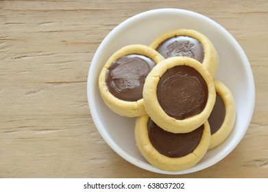 butter cookies topping chocolate cream on cup