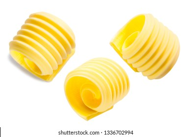 Butter curls or rolls isolated on white, top view