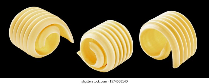 Butter curls or rolls isolated on black, a set of
