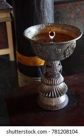 Butter lamp for Buddhist ceremonies, Lamayuru gompa monastery, Ladakh, India