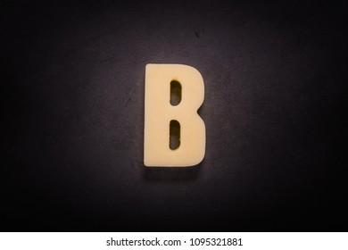 Butter Letter B  on black cast iron skillet