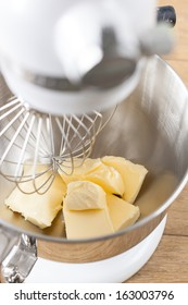 Butter in a mixer bowl