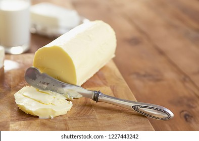 Butter on a cutting board with knipe