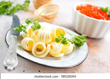 butter on plate and on a table, stock photo