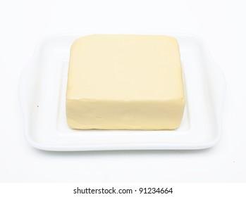 butter on white butterdish over white