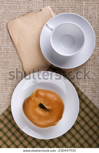Butter a round bun with a hole.