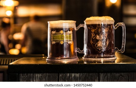 Butterbeer at the Three Broomsticks. Delicious beverage imagined by JK Rowling. Shot at the Wizarding World of Harry Potter at Universal Studios Orlando, Florida. July 2019. Close up of the beer.