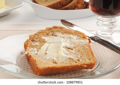 buttered banana nut bread with a cup of coffee