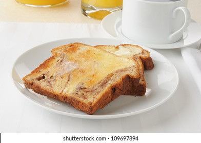 Buttered cinnamon toast with coffee and orange juice