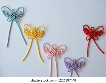 Butterfly patterned colorful knots