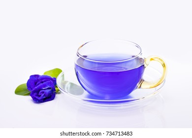 Butterfly pea or Blue pea flower herbal tea and dry butterfly pea flower on white background