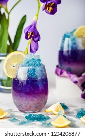 Butterfly pea flower blue ice lemonade with lemon and coconut syrup