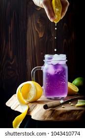 Butterfly pea flower blue iced tea or lemonade. Healthy detox herbal drink