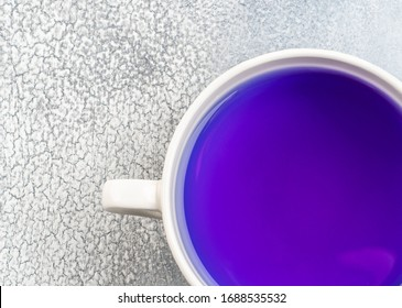 Butterfly pea flower blue tea. Healthy detox herbal drink on light background
