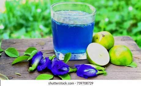 Butterfly Pea Flower juice  placed on the old wooden background.