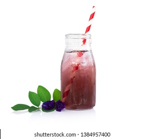 Butterfly pea juce in grass bottle with leaf and flower on white background, herb dink for healthy concept