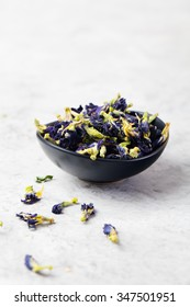 Butterfly pea tea Anchan Dried flowers to make tea Stone background