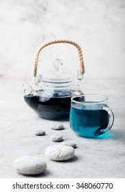 Butterfly pea tea Anchan Relaxing scene Grey pebbles Stone background