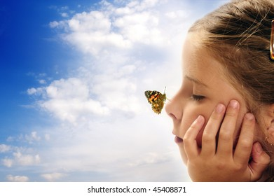 butterfly resting on the nose of al girl, concept for dreams, positive future, imagination and children creative mind
