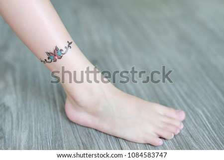 Butterfly Tattoo Sticker On Child Leg Stock Photo Edit Now